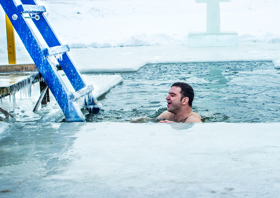 Kamenetz-Podolsk. UKRAINE. January 19. 2017. The man bathes in an ice hole. Feast of the Epiphany.
