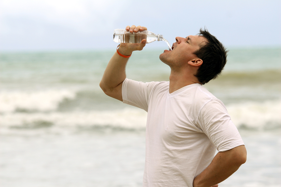 man drinking water after sport training outdoor