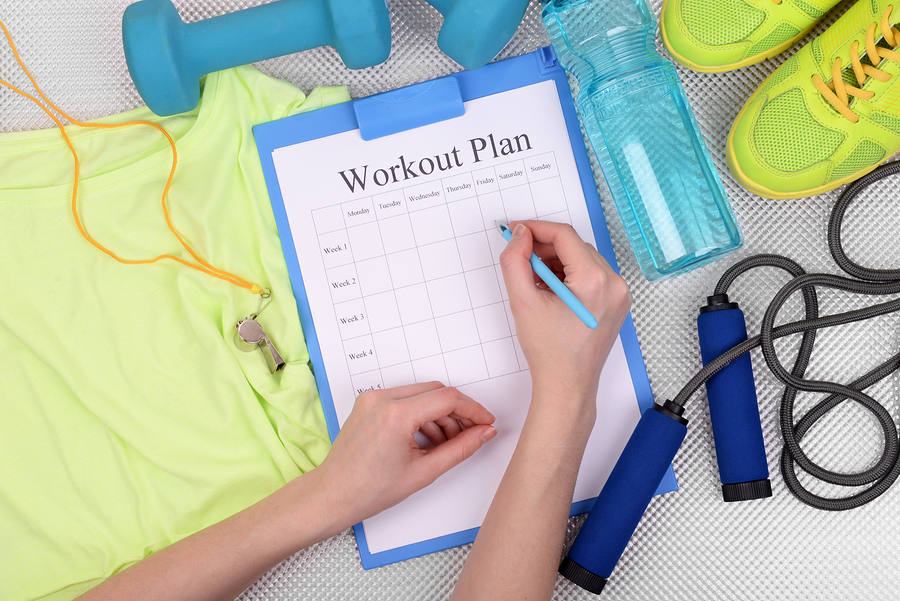 Sports trainer amounts to workout plan close-up